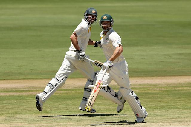 CENTURION, SOUTH AFRICA - FEBRUARY 12: Shaun Marsh and Alex Doolan of Australia run between the wickets during day one of the First Test match between South Africa and Australia on February 12, 2014 in Centurion, South Africa. (Photo by Morne de Klerk/Getty Images)