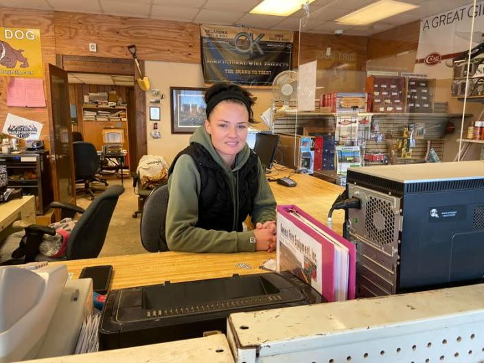 Anslee Payne poses for photo at her job at Owens Farm Equipment in Homer