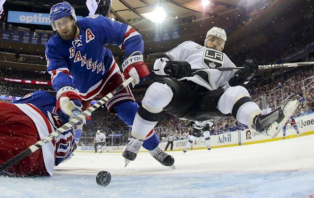 Los Angeles Kings right wing Marian Gaborik (12), right, falls as New York Rangers defenseman Dan Girardi (5) looks to clear the puck away from the goal in the third period during Game 3 of the NHL hockey Stanley Cup Final, Monday, June 9, 2014, in New York