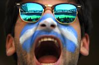 <p>An Argentina fan enjoys the pre match atmosphere prior to to the 2018 FIFA World Cup Russia group D match between Argentina and Iceland at Spartak Stadium on June 16, 2018 in Moscow, Russia. (Photo by Matthias Hangst/Getty Images) </p>