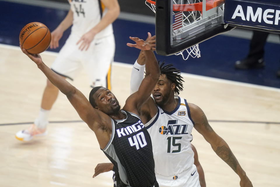Sacramento Kings forward Harrison Barnes (40) pulls down a rebound as Utah Jazz center Derrick Favors (15) defends in the first half during an NBA basketball game Saturday, April 10, 2021, in Salt Lake City. (AP Photo/Rick Bowmer)