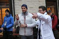 Norway's Aksel Lund Svindal, centre, gestures during a media briefing in the Rosa Khutor ski resort in Krasnaya Polyana, Russia at the Sochi 2014 Winter Olympics, Monday, Feb. 17, 2014. Svindal is leaving the Olympics because he has problems with allergies and fatigue, the Norwegian men's Alpine skiing coach said Monday. (AP Photo/Christophe Ena)