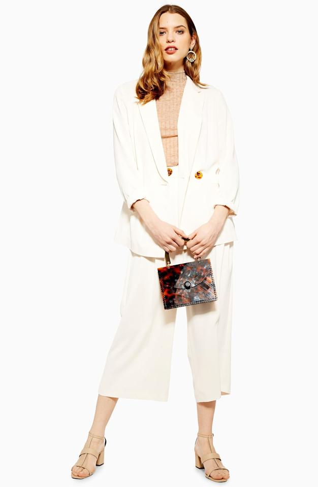 """<p>You can mix and match this <a href=""""https://www.popsugar.com/buy/Topshop-Rita-Blazer-482861?p_name=Topshop%20Rita%20Blazer&retailer=shop.nordstrom.com&pid=482861&price=75&evar1=fab%3Aus&evar9=46525419&evar98=https%3A%2F%2Fwww.popsugar.com%2Fphoto-gallery%2F46525419%2Fimage%2F46525430%2FTopshop-Rita-Blazer&list1=shopping%2Cfall%20fashion%2Ctopshop%2Cfall&prop13=api&pdata=1"""" rel=""""nofollow"""" data-shoppable-link=""""1"""" target=""""_blank"""" class=""""ga-track"""" data-ga-category=""""Related"""" data-ga-label=""""https://shop.nordstrom.com/s/topshop-rita-blazer/5251204?origin=category-personalizedsort&amp;breadcrumb=Home%2FBrands%2FTopshop&amp;color=ivory"""" data-ga-action=""""In-Line Links"""">Topshop Rita Blazer</a> ($75) with just about everything.</p>"""