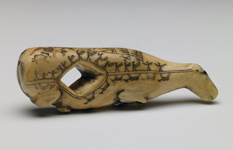 Early 19th century Alaskan arrow straightener carved in the shape of a caribou fawn and engraved with butchering instructions© Trustees of the British Museum