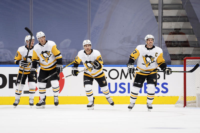 Jake Guentzel #59, John Marino #6, Conor Sheary #43 and Sidney Crosby #87 of the Pittsburgh Penguins