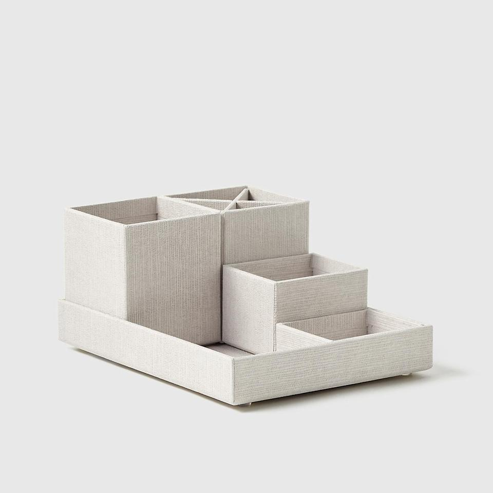 <p>If you've got lots of little knickknacks, pick up this <span>Marie Kondo Calm Desktop Organizer Set</span> ($18).</p>