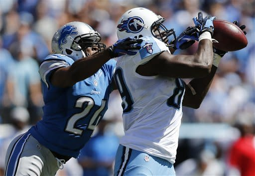 Tennessee Titans tight end Jared Cook (89) catches a touchdown pass as he is defended by Detroit Lions strong safety Erik Coleman (24) in the second quarter of an NFL football game on Sunday, Sept. 23, 2012, in Nashville, Tenn. (AP Photo/Joe Howell)