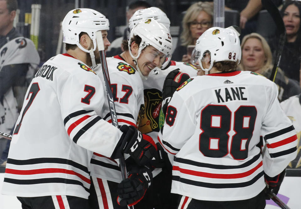 Chicago Blackhawks celebrate after center Dylan Strome (17) scored against the Vegas Golden Knights during the third period of an NHL hockey game Wednesday, Nov. 13, 2019, in Las Vegas. (AP Photo/John Locher)