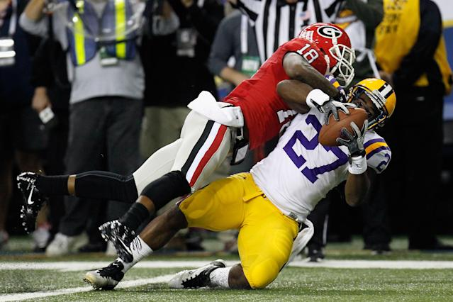 ATLANTA, GA - DECEMBER 03: Kenny Hilliard #27 of the LSU Tigers scores a 15-yard rushing touchdown in the third quarter against Bacarri Rambo #18 of the Georgia Bulldogs during the 2011 SEC Conference Championship at Georgia Dome on December 3, 2011 in Atlanta, Georgia. (Photo by Kevin C. Cox/Getty Images)