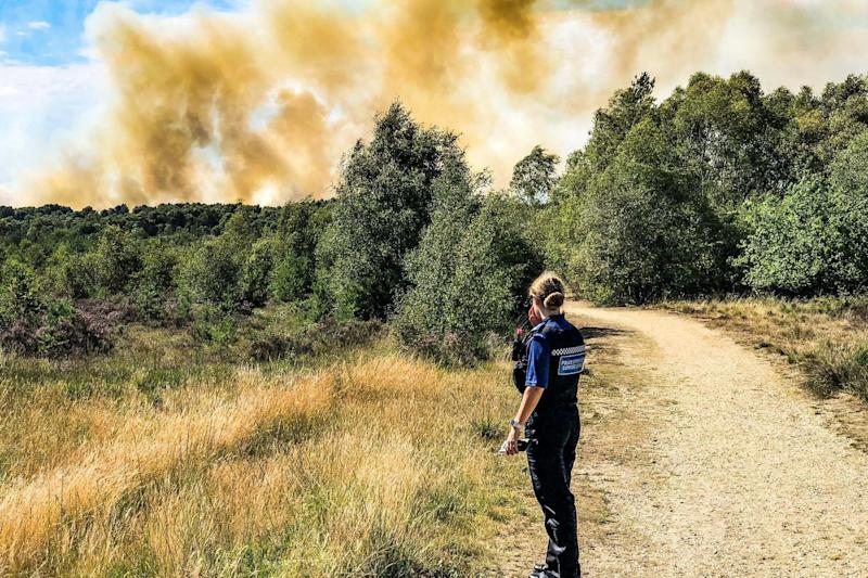 Smoke was seen for miles around as the blaze tore through the Chobham nature reserve (PA)