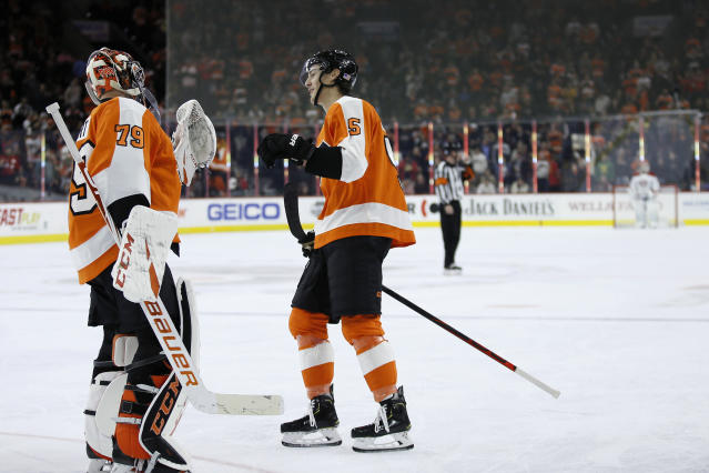 Philadelphia Flyers' Philippe Myers (5) and Carter Hart (79) celebrate after a goal by Myers during the first period of an NHL hockey game against the Montreal Canadiens, Thursday, Nov. 7, 2019, in Philadelphia. (AP Photo/Matt Slocum)