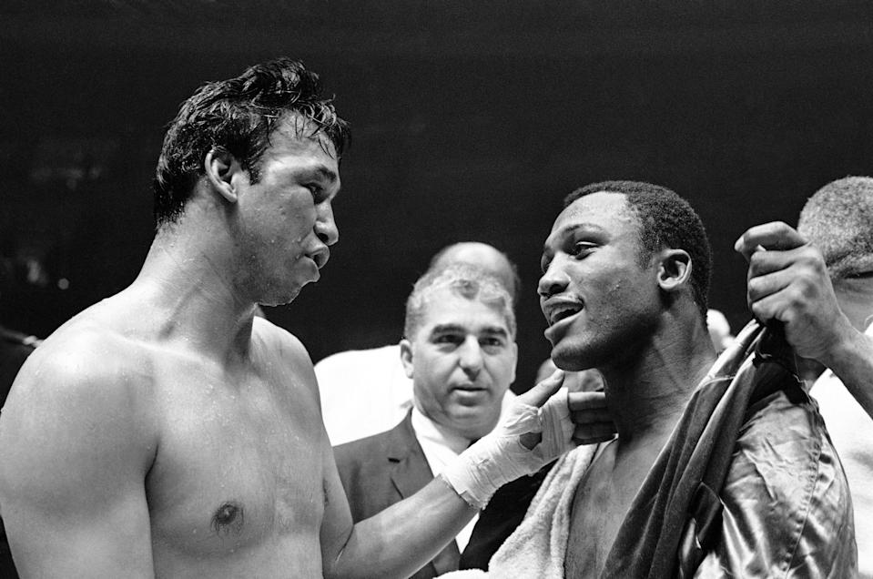 Mexico's Manuel Ramos puts a hand on the shoulder of Joe Frazier after Frazier scored a TKO in the second round of their heavyweight title fight on June 24, 1968, in Madison Square Garden. (AP Photo/Jerry Mosey)