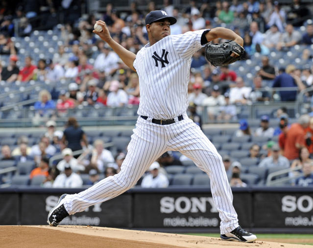 New York Yankees pitcher Ivan Nova delivers to the San Francisco Giants during the first inning of an inter-league baseball game Saturday, Sept. 21, 2013, at Yankee Stadium in New York. (AP Photo/Bill Kostroun)