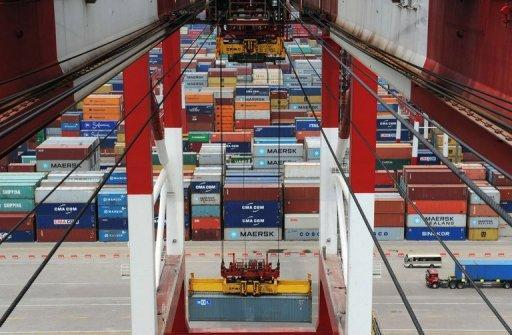 Containers are being loaded at Qingdao port in east China's Shandong province. China's manufacturing activity fell to its lowest level in more than three years in August, according to a survey compiled by HSBC