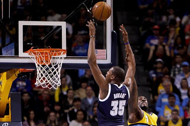 Oklahoma City Thunder's Kevin Durant (35) is fouled by Denver Nuggets' J.J. Hickson (7) during the first quarter of an NBA basketball game Thursday, Jan. 9, 2014, in Denver. (AP Photo/Barry Gutierrez)