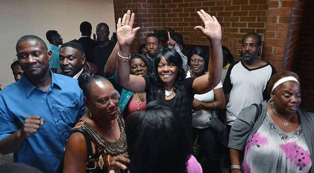 Geraldine Brown, sister of Leon Brown, celebrates outside a courtroom where her brothers were declared innocent. Picture: AP