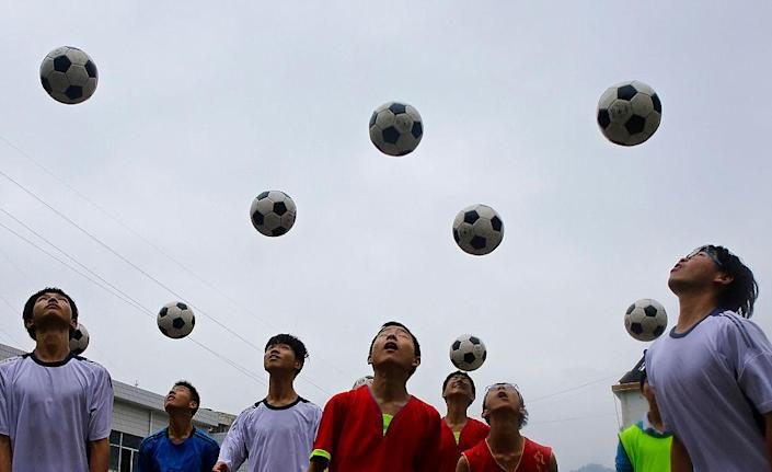 """Chinese students are seen during a football training session in the campus of the Yuyang Middle School in Wufeng Tujia Nationality Autonomous County of Yichang on June 1, 2016, in Hubei province, China.<span class=""""copyright"""">Getty Images—2016 Wang He</span>"""