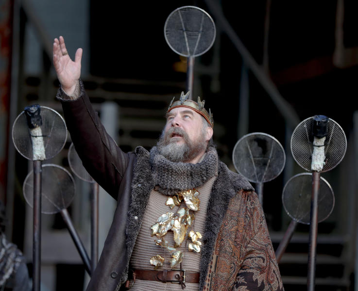 In this Saturday, May 18, 2019, photo actor Jeffrey Carpenter, portraying the character King Lear, performs in the opening scene of the Quantum Theatre production of Shakespeare's tragedy at the site of the old Carrie steel producing blast furnace in Swissvale, Pa. Karla Boos, the artistic director said using this backdrop gives a sense of the enormity of the steel industry and the enormity of its collapse and those are wonderful metaphors for the play. (AP Photo/Keith Srakocic)