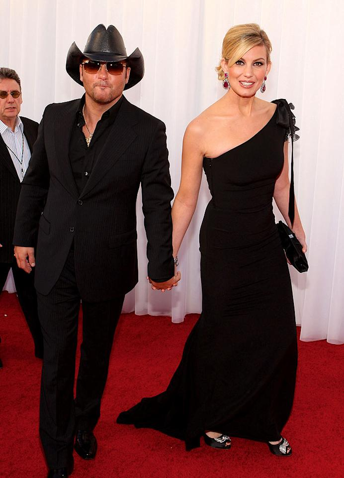 "Country royals Tim McGraw and Faith Hill sported sleek ensembles. Faith opted for a single-shouldered Valentino gown, while Tim kept it simple in a striking suit. John Shearer/<a href=""http://www.wireimage.com"" target=""new"">WireImage.com</a> - February 1, 2008"