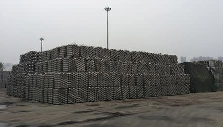 Aluminum ingots are piled up at a bonded storage area at the Dagang Terminal of Qingdao Port, in Qingdao, Shandong province, in this June 7, 2014 file photo. REUTERS/Fayen Wong/Files