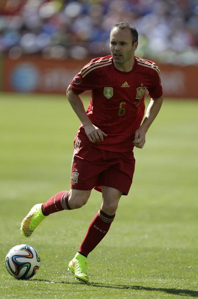 In this June 7, 2014 photo, Spain's Andres Iniesta wears his Nike Magista cleats during an exhibition soccer game against El Salvador in Landover, Md. The competition on the pitch in has yet to start, but the fight over World Cup consumers is already intense _ and no more so than between the athletic companies that are jockeying for their once-every-four-years shot at the ever-growing soccer market(AP Photo/Luis M. Alvarez)