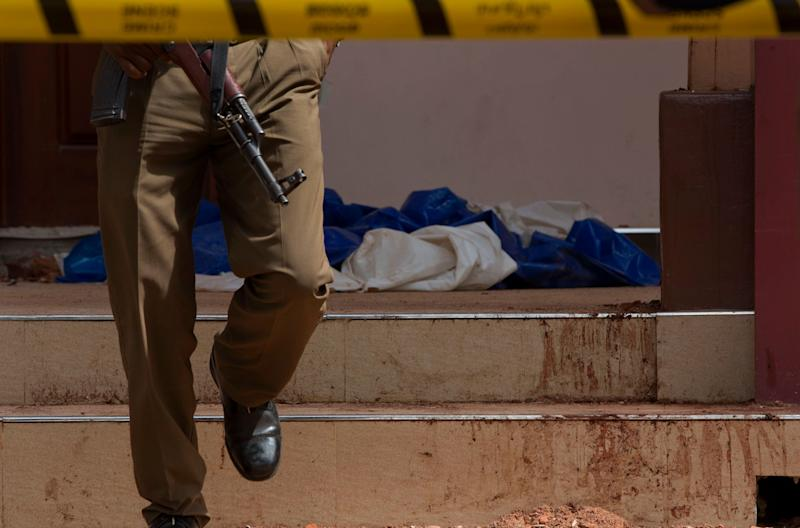 A policeman walks close to blood-stained stairs at the scene of a suicide bombing at St. Sebastian Church in Negombo, Sri Lanka, April 22, 2019. (Photo: Gemunu Amarasinghe/AP)