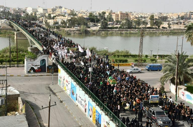 Large numbers of Iraqi Shiites defy curfews imposed to stem the spread of the coronavirus to commemorate a revered imam