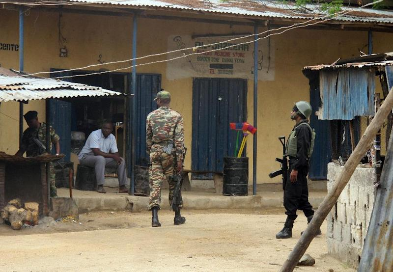 Cameroonian soldiers patrol in the town of Amchide on the border with Nigeria on June 17, 2014
