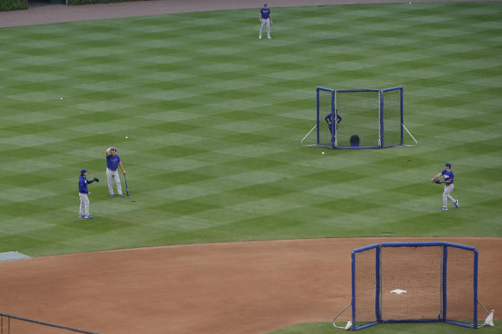 CORRECTS YEAR TO 2021-Los Angeles Dodgers players finishing off practice at Wrigley Field as a baseball game against the Chicago Cubs has been postponed due to the forecast of inclement weather, Monday, May 3, 2021, in Chicago. (AP Photo/Kamil Krzaczynski)