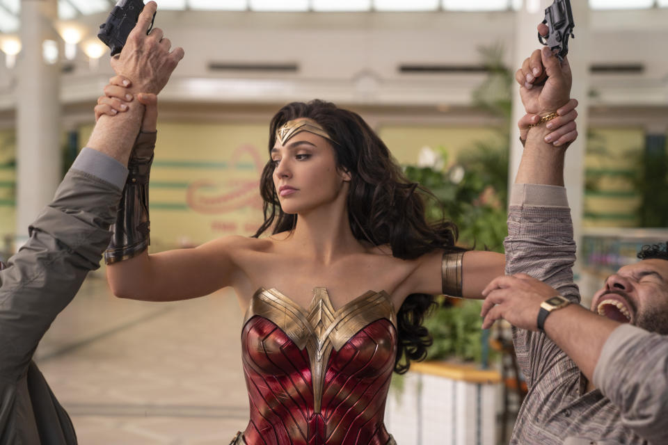 """This image released by Warner Bros. Entertainment shows Gal Gadot in a scene from """"Wonder Woman 1984."""" WarnerMedia last week announced that """"Wonder Woman 1984"""" -- a movie that might have made $1 billion at the box office in a normal summer -- will land in theaters and on HBO Max nearly simultaneously next month. (Clay Enos/Warner Bros. Entertainment via AP)"""
