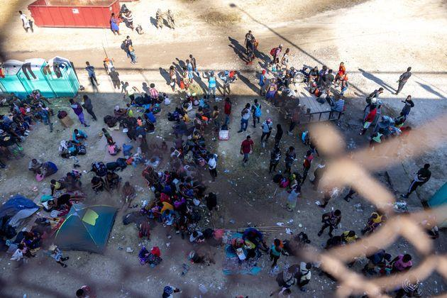 Migrants, mostly from Haiti, gather at a makeshift encampment under an overpass on the border between Del Rio, Texas, and Acuña, Mexico, on Sept. 17. (Photo: Jordan Vonderhaar via Getty Images)