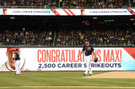 The scoreboard congratulates Washington Nationals starting pitcher Max Scherzer, center, after he recorded his 2,500th career strikeout during the sixth inning of a baseball game against the San Diego Padres, Friday, April 26, 2019, in Washington. (AP Photo/Nick Wass)