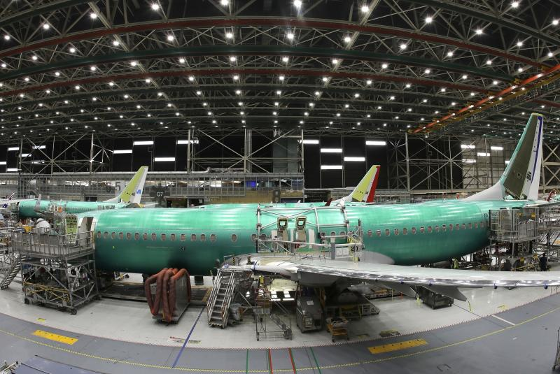FILE- In this March 27, 2019, file photo, a Boeing 737 MAX 8 airplane is shown on the assembly line during a brief media tour in Boeing's 737 assembly facility, in Renton, Wash. Flyadeal, a Saudi budget carrier says it is ordering 30 new Airbus planes, replacing a $6 billion agreement it had with Boeing for its troubled 737 MAX jets, which are grounded around the world after two crashes.  (AP Photo/Ted S. Warren, File)