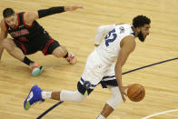 Minnesota Timberwolves center Karl-Anthony Towns (32) leaves Chicago Bulls center Nikola Vucevic (9) on the floor in the first quarter during an NBA basketball game, Sunday, April 11, 2021, in Minneapolis. (AP Photo/Andy Clayton-King)