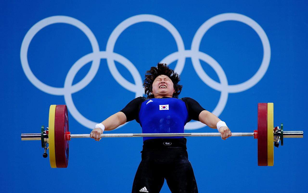LONDON, ENGLAND - AUGUST 01:  Yura Mun of Korea competes in the Women's 69kg Weightlifting on Day 5 of the London 2012 Olympic Games at  ExCeL on August 1, 2012 in London, England.  (Photo by Laurence Griffiths/Getty Images)