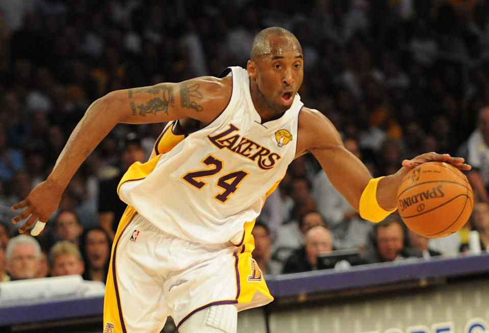 Kobe Bryant in the white Lakers jersey.