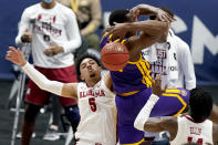 Alabama's Jaden Shackelford (5) fights for a rebound against LSU during the first half of the championship game at the NCAA college basketball Southeastern Conference Tournament Sunday, March 14, 2021, in Nashville, Tenn. (AP Photo/Mark Humphrey)