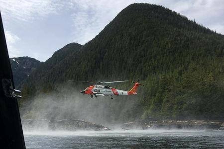 A Coast Guard Air Station Sitka MH-60 Jayhawk helicopter crew hovers while searching for a survivor from a report of two aircraft colliding in the vicinity of George Inlet near Ketchikan, Alaska, U.S., May 13, 2019. Courtesy photo by Ryan Sinkey/U.S. Coast Guard/Handout via REUTERS