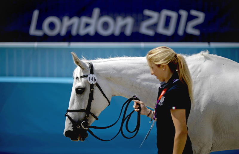 Italy rider Vittoria Panizzon and her horse Borough Pennyz trot through a horse inspection for the equestrian eventing competition in Greenwich Park at the 2012 Summer Olympics, Wednesday, July 25, 2012, in London. (AP Photo/David Goldman)