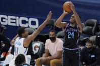 Sacramento Kings guard Buddy Hield (24) shoots over Oklahoma City Thunder guard Theo Maledon (11) in the first half of an NBA basketball game Tuesday, May 4, 2021, in Oklahoma City. (AP Photo/Sue Ogrocki)