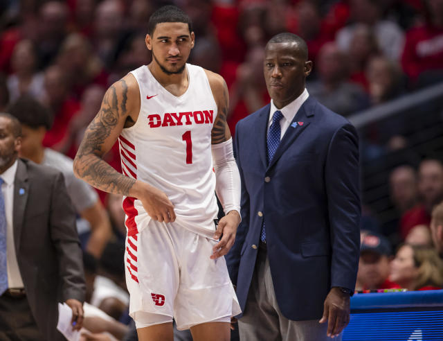 Dayton's Obi Toppin and coach Anthony Grant look on during a game against Fordham on Feb. 1. (Michael Hickey/Getty Images)