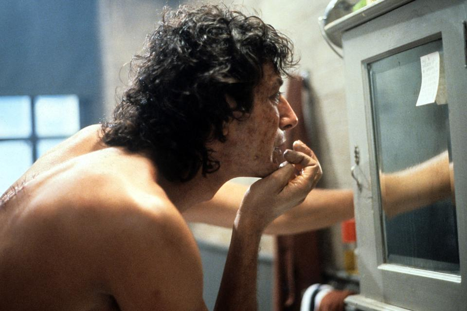 Jeff Goldblum looks in a mirror in a scene from the film 'The Fly', 1986. (Photo by 20th Century-Fox/Getty Images)