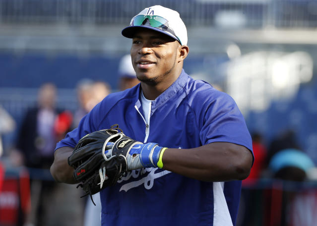 Los Angeles Dodgers right fielder Yasiel Puig, left, smiles during batting practice before a baseball game against the Washington Nationals at Nationals Park, Tuesday, May 6, 2014, in Washington. (AP Photo/Alex Brandon)