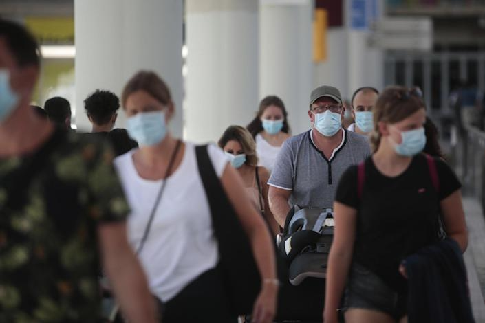 Passengers wearing face masks arrive at Son Sant Joan airport on the Spanish Balearic Island of Mallorca on Monday: AP