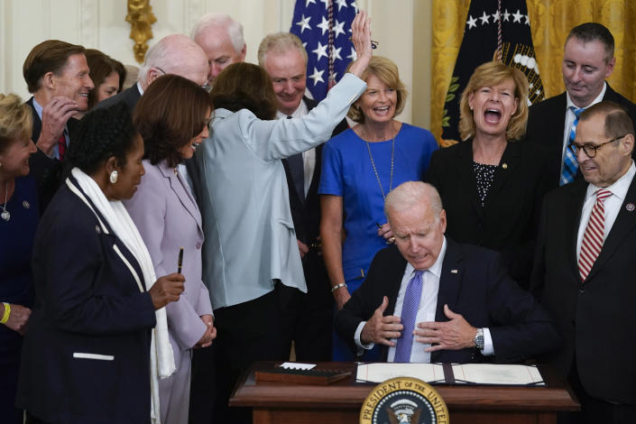 After not receiving a pen, Sen. Dianne Feinstein, D-Calif., raises her hand as President Joe Biden reacts after he ran out of pens to hand out after he signed H.R. 1652, the VOCA Fix to Sustain the Crime Victims Fund Act of 2021, in the East Room of the White House, Thursday, July 22, 2021, in Washington. (AP Photo/Andrew Harnik)