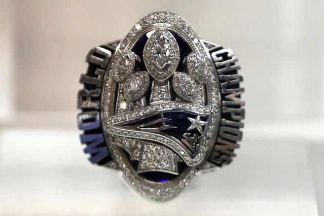 Robert Kraft's 283-diamond ring from the 28-3 Super Bowl — like the one seen here — is raising a lot of money. (AP Photo/Gregory Payan, File)