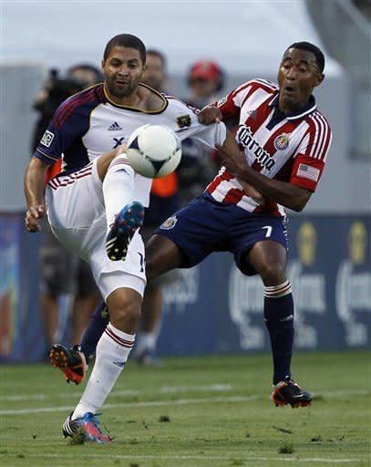 Chivas USA defender James Riley, right, pulls on the jersey of Real Salt Lake forward Alvaro Saborio, left, of Costa Rica, to defend during the first half of an MLS soccer match in Carson, Calif., Saturday, June 16, 2012. (AP Photo/Alex Gallardo)