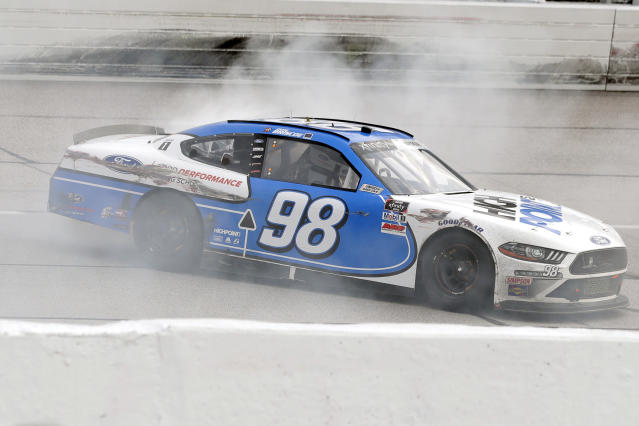 Chase Briscoe does a burnout after winning the NASCAR Xfinity series auto race Thursday, May 21, 2020, in Darlington, S.C. (AP Photo/Brynn Anderson)