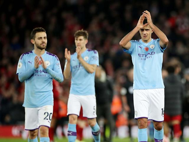 Manchester City's Rodri and Bernardo Silva applaud the fans after the match: Action Images via Reuters
