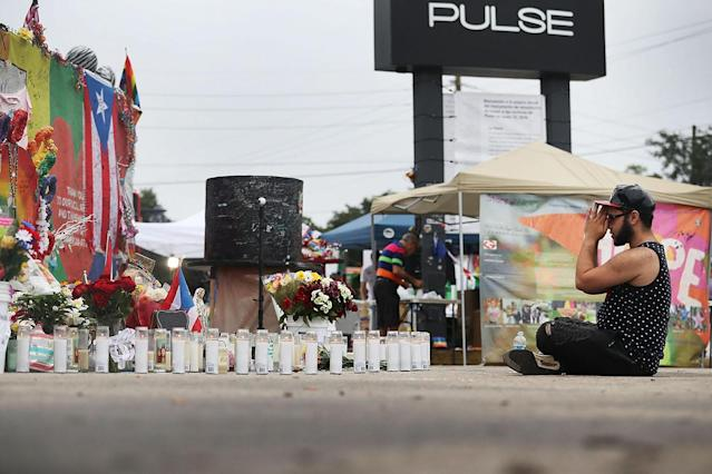 <p>Jose Ramirez who survived the mass shooting at the Pulse gay nightclub reacts as he visits the site one year after the shooting on June 12, 2017 in Orlando, Florida. (Joe Raedle/Getty Images) </p>